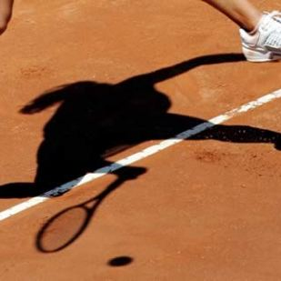 France's Amelie Mauresmo casts a shadow as she returns a shot during her final tennis match against Switzerland's Patty Schnyder at the Italian Masters tennis tournament in Rome May 15, 2005.