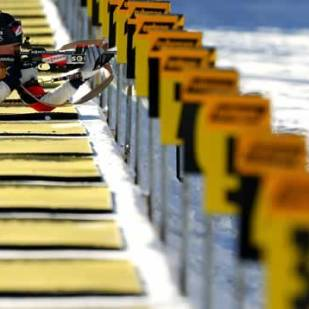 France's Raphael Poiree shoots during the men's 10 kms sprint competition at the Biathlon World Cup in the northern Italian skiing resort of Anterselva, January 24, 2004.