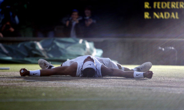 Rafael Nadal of Spain celebrates after defeating Roger Federer of Switzerland in their finals match at the Wimbledon tennis championships in London July 6, 2008.