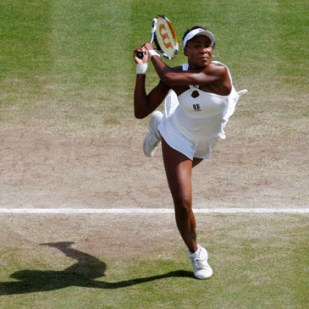 Venus Williams of the U.S. returns the ball to her sister Serena during their finals match at the Wimbledon tennis championships in London July 5, 2008.