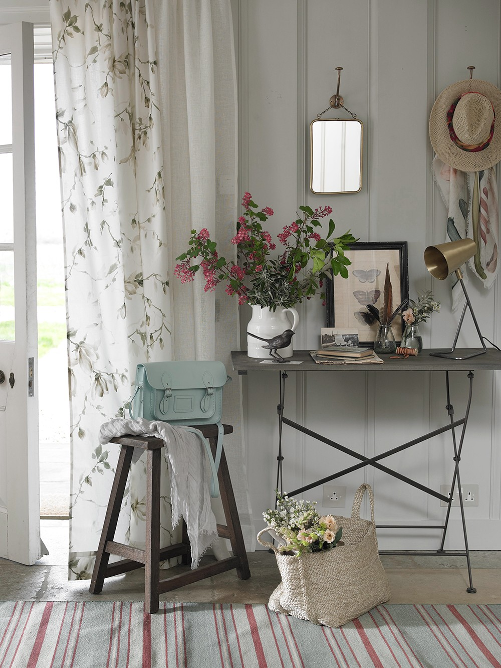 Metal legged trestle table in the hallway, combined with a brass side lamp and reclaimed stool.  Shot for Country Homes & Interiors, styled by Pippa Jameson and photographed by David Britton