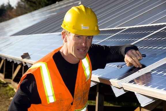 Installing solar panels. (Image Credit. Oregon of Transportation / Flickr)