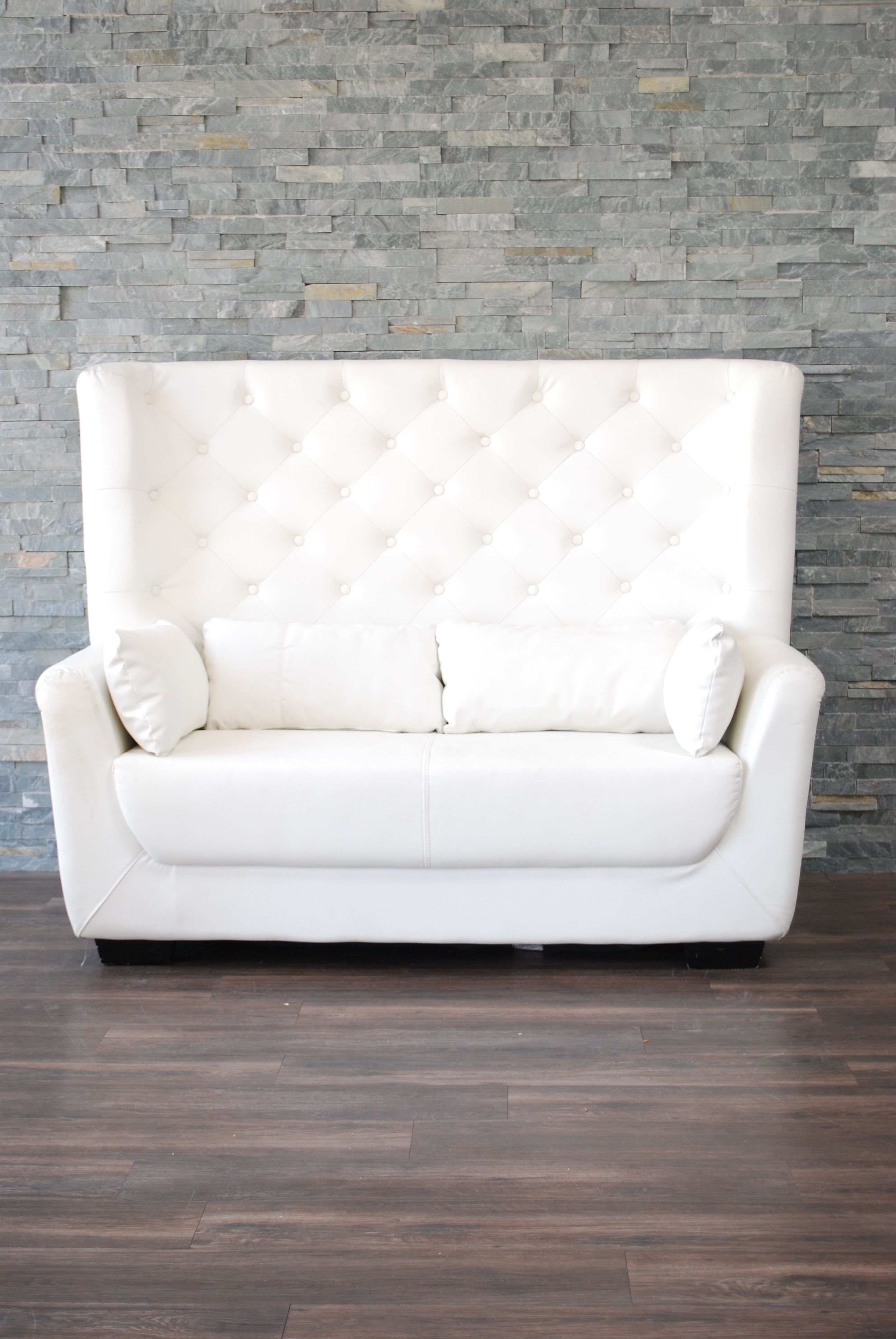 white leather high back tufted love seat