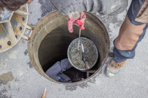 Sewer maintenance, looking down the manhole 3