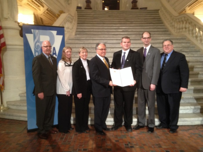 While in Harrisburg, PMEA received a resolution from the Pennsylvania House designating March as Music In Our Schools Month. The resolution also recognized the work of music educators in Pennsylvania. Pictured here are: Chuck Neidhardt, a PMEA Past President; Abi Young, PMEA Assistant Executive Director; Margaret Bauer, PMEA Executive Director; Representative Eddie Day Pashinski; Dennis Emert, PMEA President; Mark Despotakis, PMEA Advancement of Music Education Council Chair and Representative Tim Briggs.