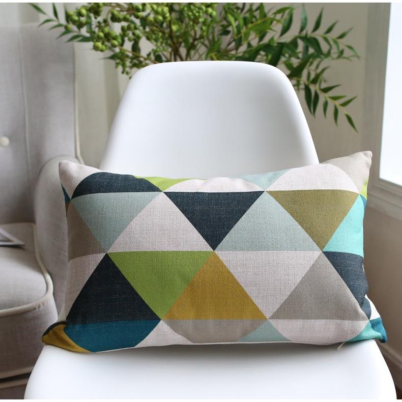 Poduszka dekoracyjna podłużna 30x50 cm w wzory geometryczne na krzes