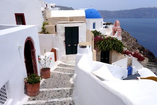santorini greece oia fira caldera aegean blue domes food black beach beer