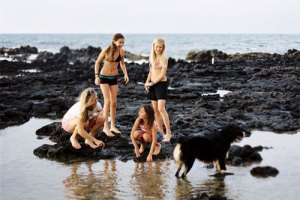 Family tidepooling at Poipu beach
