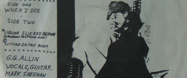 The inside sleeve artwork for the Troubled Troubadour by GG Allin showing GG Allin without any trousers on with a guitar between his legs. It is a black and white photocopied image.