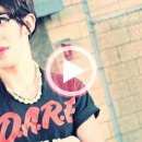 An image of the trans singer Chase who wears a black t-shirt that states D.A.R.E.