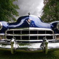 Tho' you may not drive a great big Cadillac