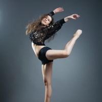 Modern style dancer posing on a studio grey background