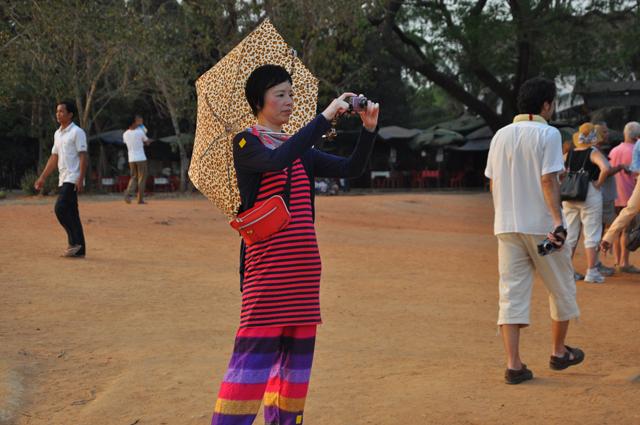 Colourful lady tourist at Angkor Wat, Cambodia