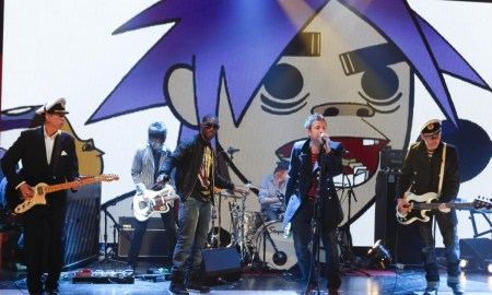 EDITORIAL USE ONLY / NO MERCHANDISING Mandatory Credit: Photo by Brian J. Ritchie/Hotsauce / Rex Features ( 1185240ay ) Gorillaz - Mick Jones, Damon Albarn and Paul Simonon 'Friday Night with Jonathan Ross' TV Programme, London, Britain - 21 May 2010 There was anarchy on this week's 'Friday Night With Jonathan Ross' with the guests rioting. The program descended into farce after comedian Ross Noble, former footballer and presenter Gary Linker and the Damon Albarn fronted band Gorillaz all carried out an orchestrated attack on Jonathan. The boisterous fun saw them all piling onto the sofa, clambering over Jonathan's desk and pinning him to the floor as they playfully pummeled him. It was comedian Noble who started off the high jinks when he insisted that he and Jonathan swapped seats. When he refused, Noble tried to pull Jonathan away from the desk but he held on tightly. Unable to move him Noble then leapt on top of Jonathan and a scuffle broke out. Order was eventually restored until second guest Gary entered the set and immediately leapt on Jonathan. The mayhem continued after Gorillaz had performed and decided that they too wanted to join in the fun - meaning Jonathan got jumped for a third time as all the night's guests joined in.