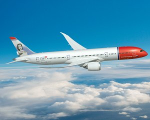 787; 787-8; Rendering; Norwegian Air; right side view; flying over clouds; Sonja Henie on tail fin; K66449