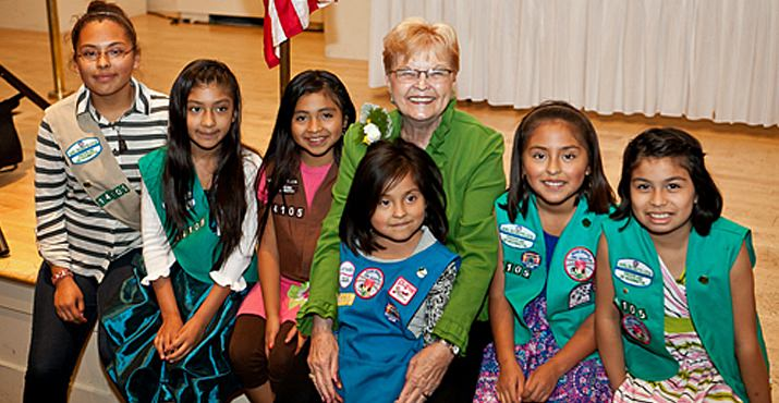Former Governor of Oregon Barbara Roberts is pictured with Girl Scout Troop 14105 of Woodburn.