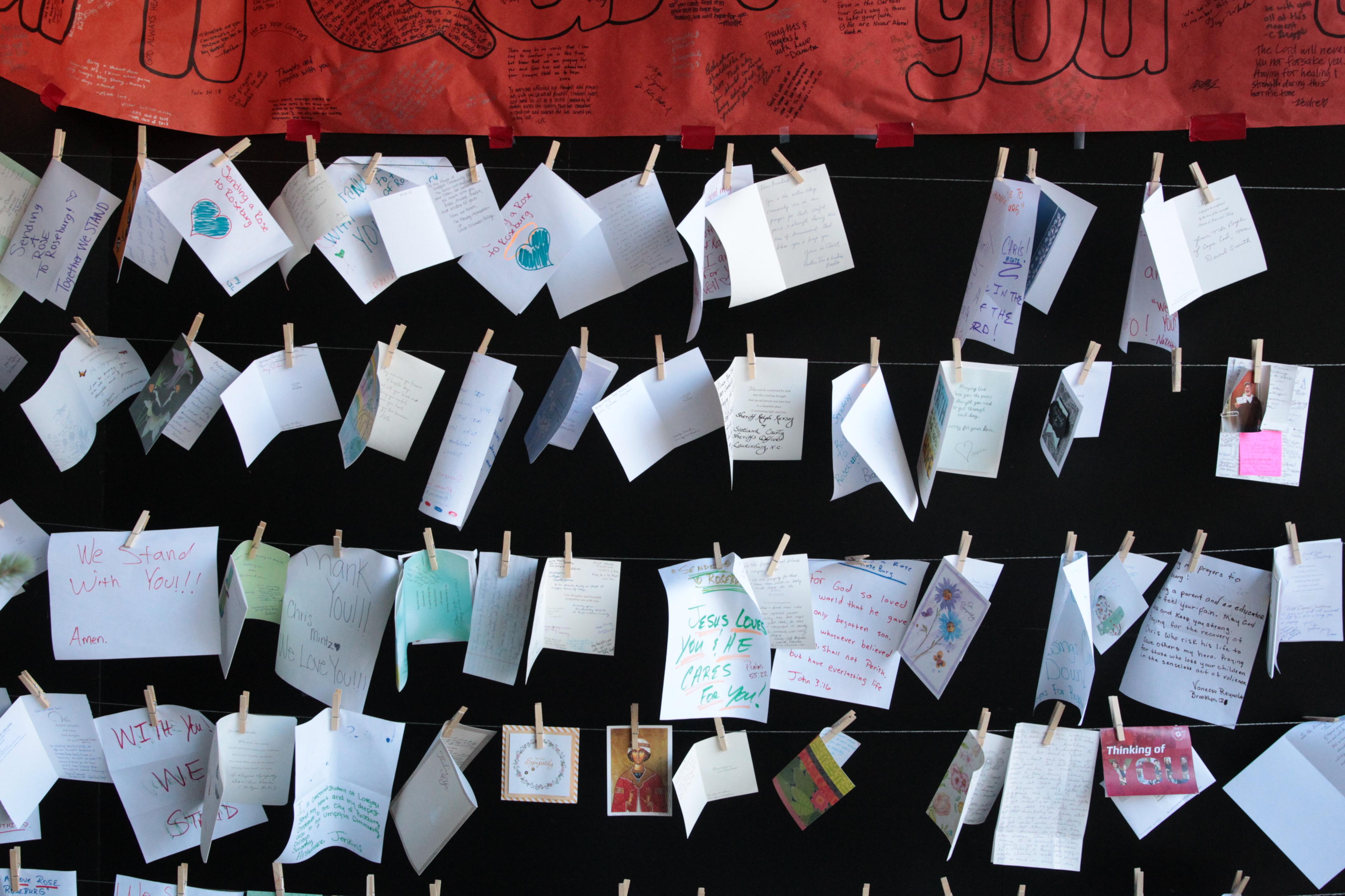 Cards hang at Umpqua Community College, Monday, Oct. 12, 2015, in Roseburg, Oregon. (Beth Nakamura/The Oregonian via AP, Pool)