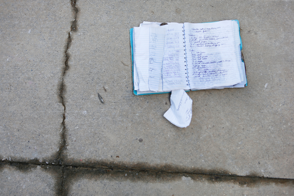 A notebook full of handwritten family recipes set out to dry on the driveway at the home of Earl and Julie Hebert in Denham Springs on Wednesday, Aug. 17. The area had several feet of water during the historic flood this week. (Photo by Chris Granger, Nola.com | The Times-Picayune)