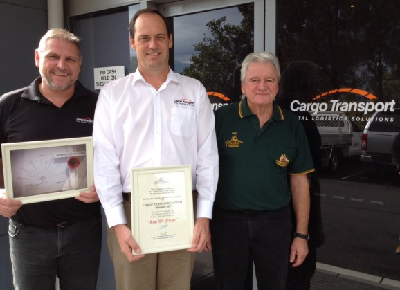 With Vice President Mike Lee is Cargo Transport System team Director Alister Campbell (centre) and General Manager David Brough (left), holding their Pozieres Memorial Park Brick Certificates