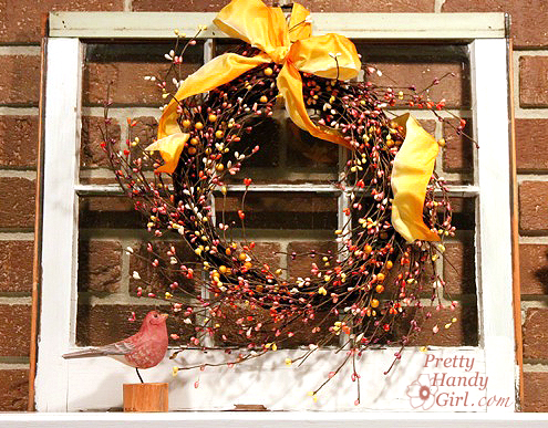 old window with wreath on mantle