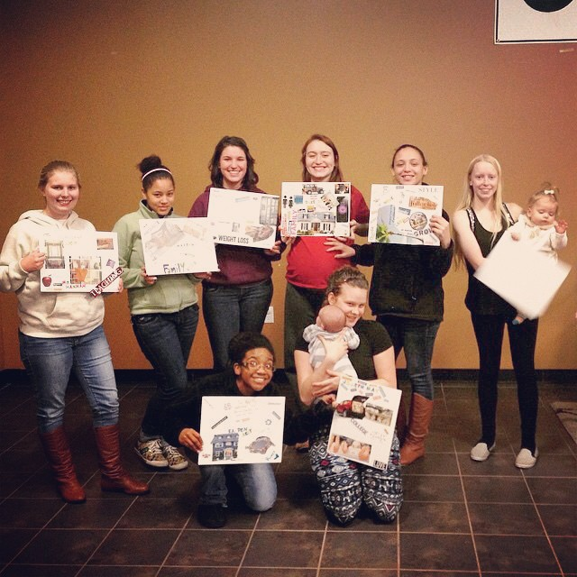 Holding their Dream Boards from our Life Skills + Parenting class.