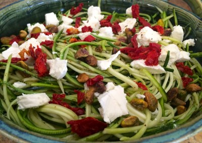 Baked Zucchini Noodles with Pistachios and Sun Dried Tomatoes