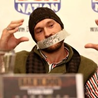 Tyson Fury enters vow of silence as he wears tape over mouth at today's press conference