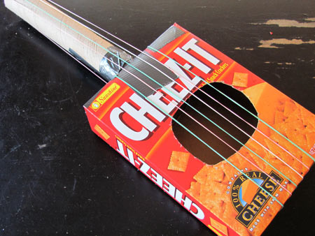 Make a toy guitar out of recycled materials - Projects for Preschoolers