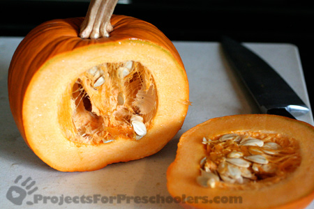 Slice a side of the pumpkin off