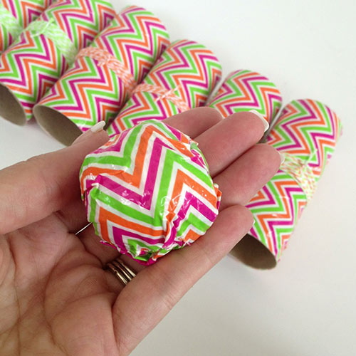 Create a round ball with the paper and Duck Tape