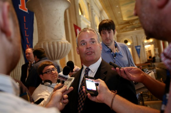 Nancy Stone/Chicago Tribune/MCT University of Illinois coach Tim Beckman speaks to the media outside the ballroom during Big Ten Media Day at the Hilton Chicago on Monday, July 28, 2014, in Chicago, Ill. Beckman will continue to coach the Illini Football team for the 2015 season.