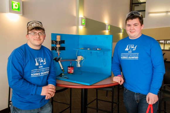 Photo by Scott Wells | The Prospectus  Mahomet Seymour High School student Cole Johnson (left) and Kenneth Buchanan (right), display the project in they designed for the Mission Possible event of the regional Science Olympiad event being hosted at Parkland College on March 7, 2015