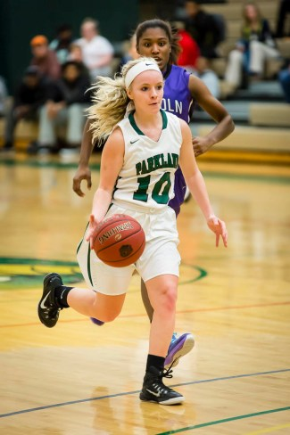 Photo by Scott Wells/Prospectus News  Freshman Guard Haley Toohill on offense during the second half of the Mar. 4, 2015 Region 24 Quarterfinal game against Lincoln College.  The Cobras defeated the Lynx 85-25 to move on in the tournament.