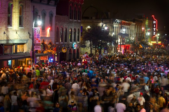 In this March 14, 2014 file photo, thousands of people cram into Sixth Street in Austin, Texas. The South by Southwest music festival will have new safety measures after last year's revelry was shattered when a driver plowed into a crowd of concertgoers.  (AP Photo/Austin American-Statesman, Jay Janner, File)
