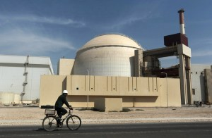 Photo by Majid Asgaripour | AP Photo/Mehr News Agency  In this Oct. 26, 2010 file photo, a worker rides a bicycle in front of the reactor building of the Bushehr nuclear power plant, just outside the southern city of Bushehr. Iran left the negotiating table in Lausanne, Switzerland, on Thursday, April 2, 2015 with a commitment to implement the Additional Protocol, IAEA's most potent monitoring instrument.