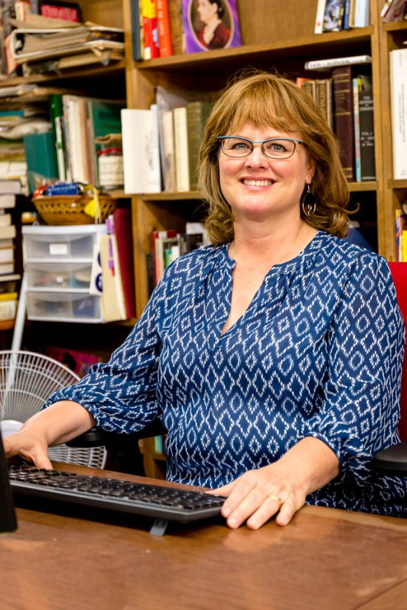 Photo by Scott Wells | Prospectus News Jane Addams Book Shop owner Susan Elmore works inside her establishment on Aug. 15, 2015. Elmore and her husband purchased the business in December, 2009.