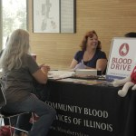 Photo by Zonghui Li | The Prospectus  A Parkland student visits Blood drive's booth during the Parkland College Volunteer Fair in the U-Wing on Wednesday, Sept. 23, 2015.