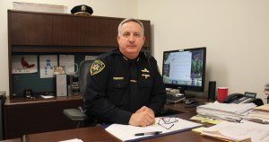 Photo by Greg Gancarz Director of Public Safety and Chief of Police, William P. Colbrook, sitting in his office.