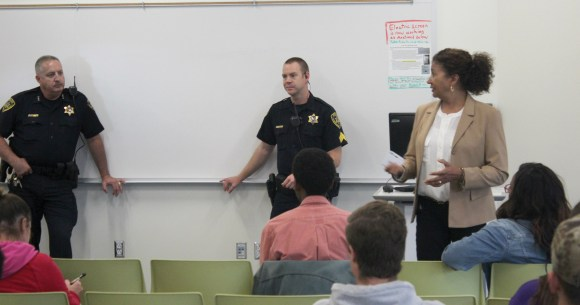 "Photo by Greg Garcarz | Donna Tanner-Harold (right), director of the Black Student SUCCESS Project, along with Chief William Colbrook (left) and Sergeant Matt Kopmann (center) from Parkland Public Safety, speak before attendees at the ""You and the Police"" discussion on Wednesday, Oct. 11, in room U140."