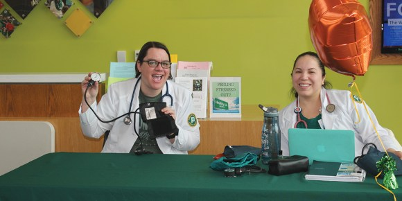Photo by EvyJo Compton | Bieke Opgenhaffen (left) and Christina Cooper (right) run the Student Nurses at Parkland (SNAP) booth where both Opgenhaffen and Cooper took students' blood pressures during the Health Services Fair on Feb. 9.