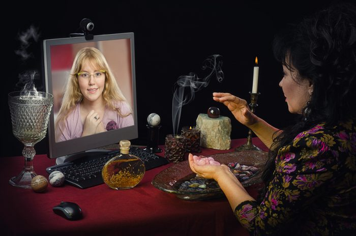 online fortune teller chatting with woman through webcam