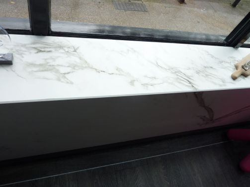Bespoke window sill covered in Dekton kent