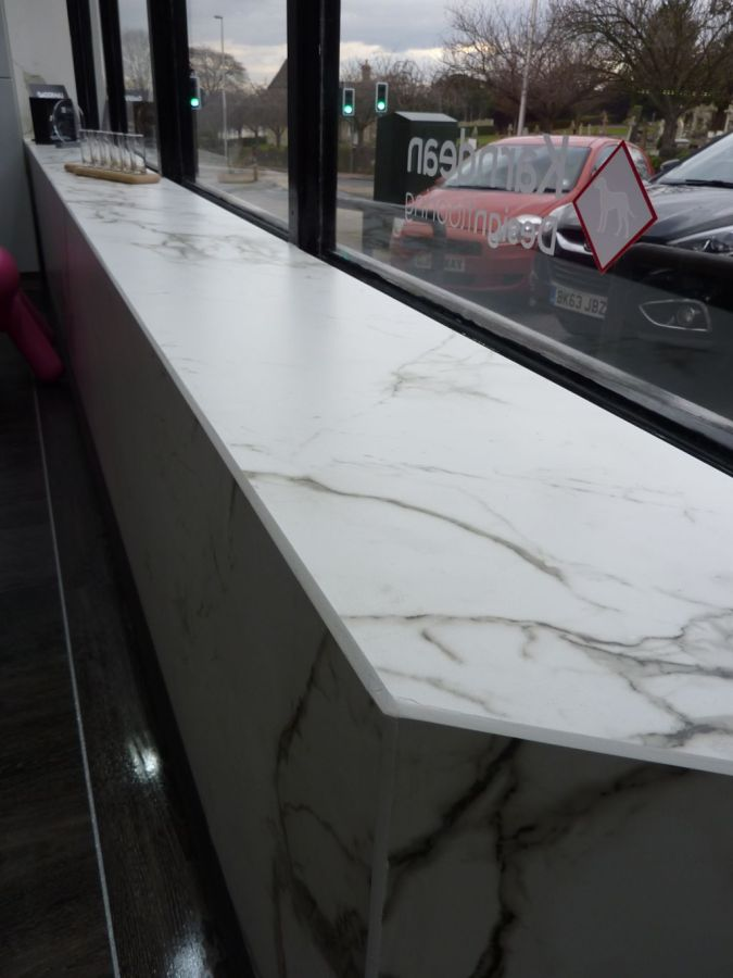 Book matched window sill in Dekton®