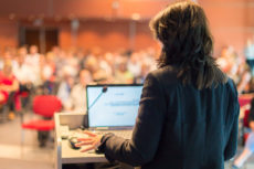 29843753 - business woman lecturing at conference  audience at the lecture hall