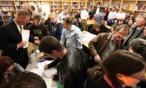 Crowds of people fill out precinct forms, paw over piles of political pamphlets and get informed at a Republican caucus meeting at the North Davis Preparatory Academy in Layton Tuesday, March 23, 2010. Brian Nicholson, Deseret News
