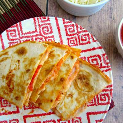 Tortilla shells stuffed with pizza sauce, cheese, and pepperoni slices will create these Easy Pizza Quesadillas, perfect for an appetizer or dinner.