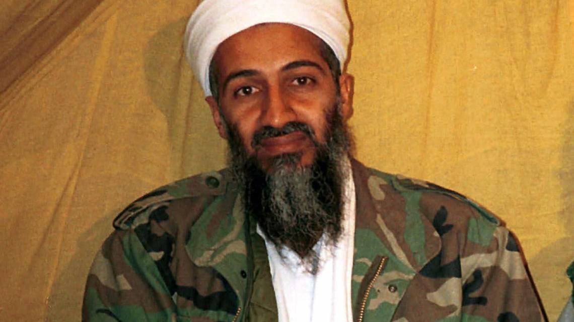 "FILE - This undated file photo shows al Qaida leader Osama bin Laden in Afghanistan. A new book due out Tuesday, Oct. 16, 2012 says President Barack Obama hoped to put Bin Laden on trial if he had surrendered during a U.S. raid. Author Mark Bowden quotes the president as saying he thought he could make a strong political argument for giving bin Laden the full rights of a criminal defendant, to show U.S. justice applies even to him. In ""The Finish,"" Bowden writes, however, that Obama said he expected the terror leader to go down fighting. (AP Photo)"
