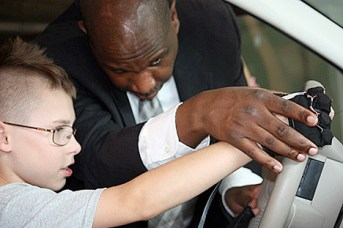Anil Lewis works with a student with disabilities in the National Federation for the Blind science, technology, engineering, and mathematics program.