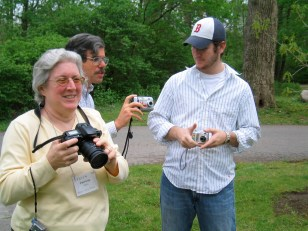 How many cam­eras does it take to make a group shot? That's Trish Carn (the UK's Quaker Monthly), Anthony Manousos (West­ern US's Friends Bulletin) and our very gra­cious photo-taker (who I think might be Ann's son?).