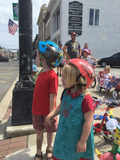 Having decorated their bikes at Toy Market, Gregory and Laura walk to the parade rallying area.